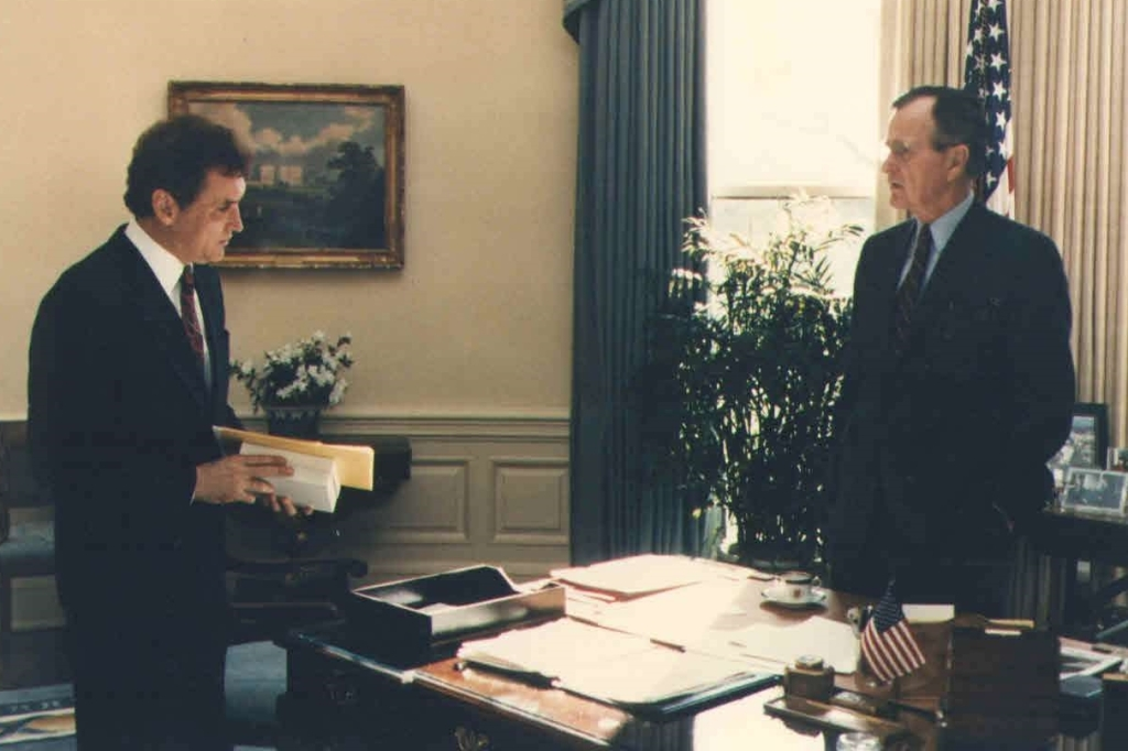 Special Advisor Doug Wead standing in the White House with President George H.W. Bush standing behind a desk