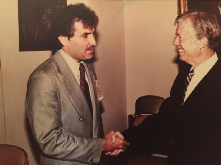 Historian, Doug Wead, shakes hands with, President Jimmy Carter