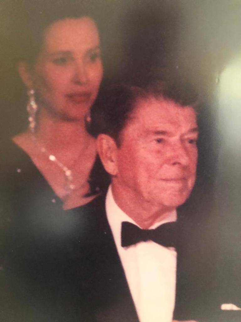 Myriam Wead, Historian, Doug Wead's wife, behind President Ronald Reagan, at the Charity Awards Dinner