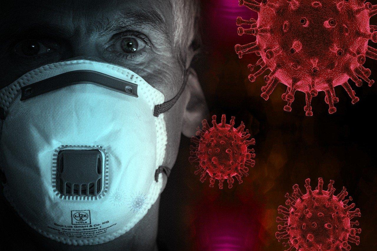 man wearing face mask, because of the coronavirus pandemic